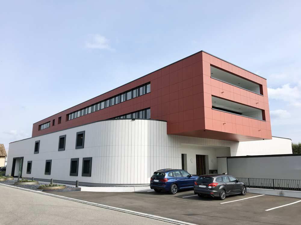 Penergetic International AG, Romanshorn | Vorgehängte hinterlüftete Fassadenbekleidung in Eternit-Faserzement auf Holzelementen, Ducksch & Anliker Architekten AG, Zürich, 2017 Fassadentechnik AG